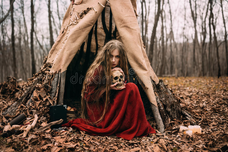 Witch in forest stock photography