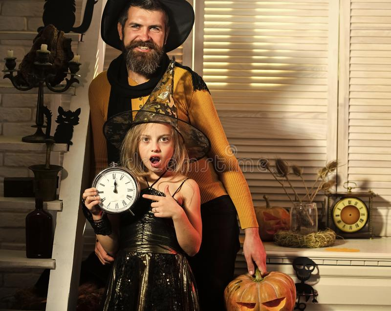 Witch girl and bearded man with surprised faces royalty free stock photography