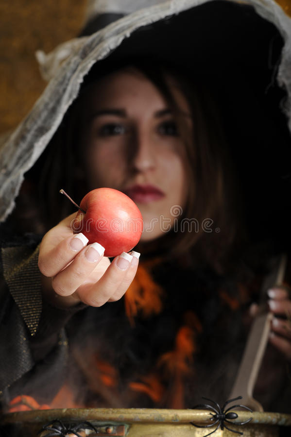 Free Witch Giving A Poisened Apple Stock Photo - 21508200