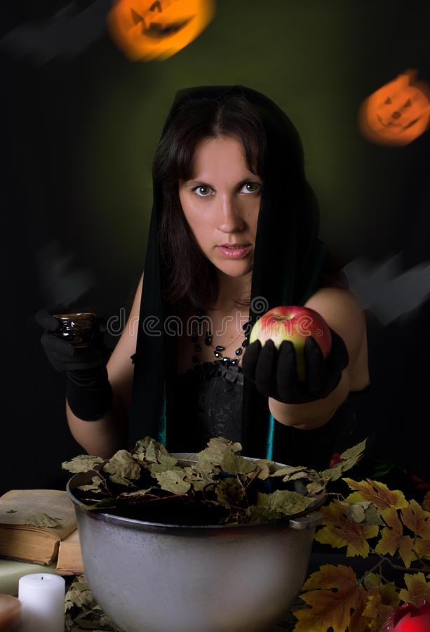 Witch giving poisoned apple royalty free stock image