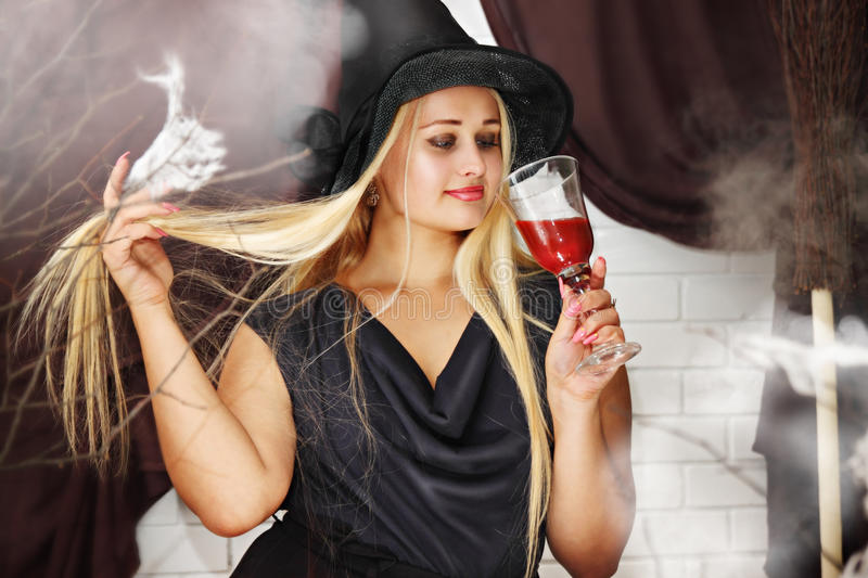 Witch with a glass of blood royalty free stock photo