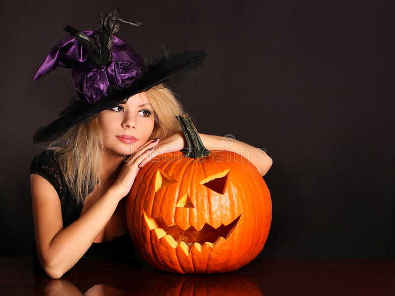 Witch with Halloween pumpkin royalty free stock photo