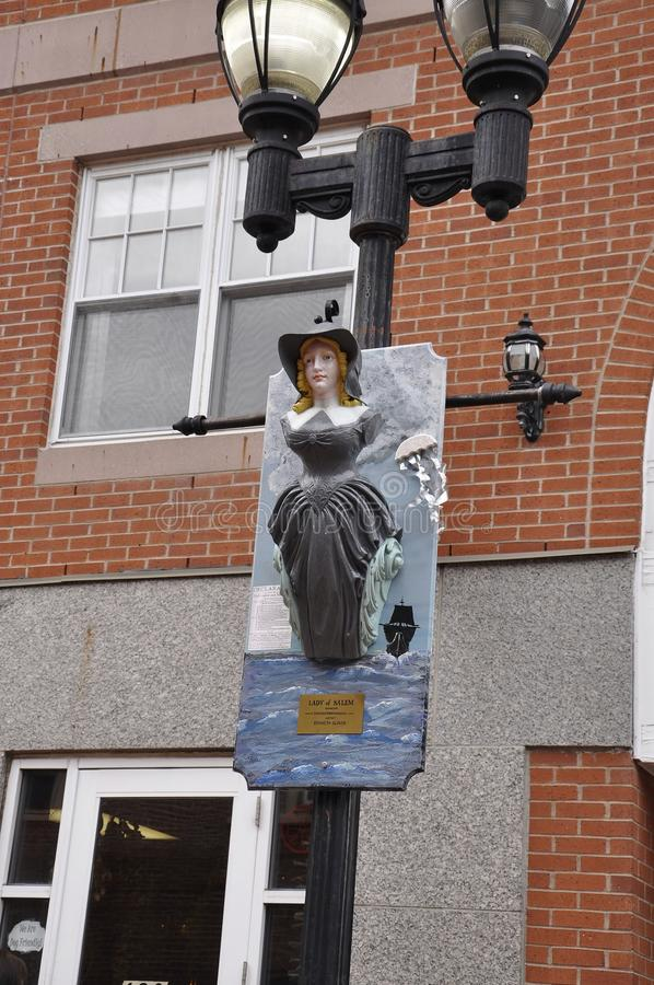 Salem, MA, 1st June: Witch hanging on pillar miniature from Salem in Essex county Massachusettes state of USA royalty free stock image