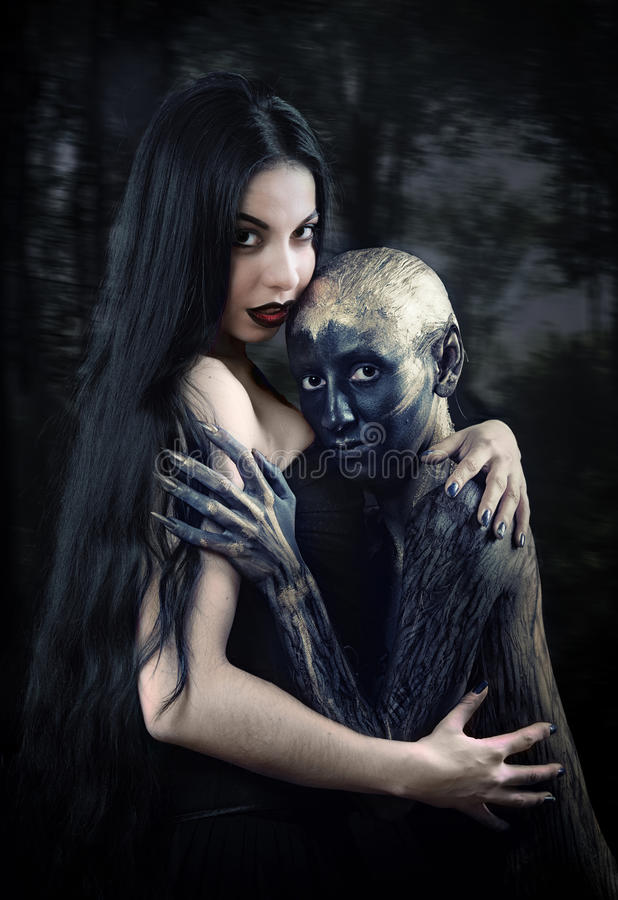Witch and her familiar. Fantasy style portrait of two women in body art royalty free stock photo