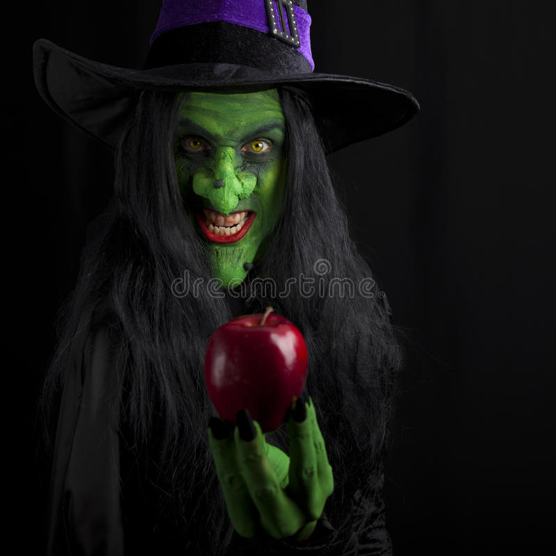 Witch and her poisonous red apple.