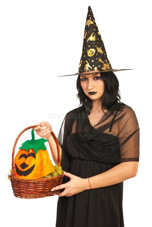 Witch Holding Basket Stock Photo