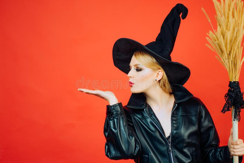Witch holding broom or broomstick. appy gothic young woman in witch halloween costume. Halloween concept. Copy space.  stock image