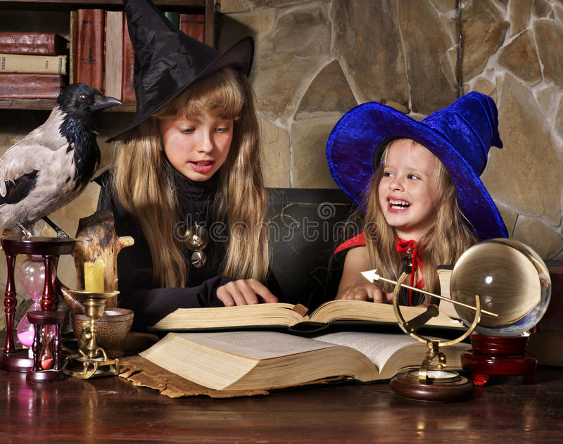 Witch kid with crystal ball. royalty free stock images