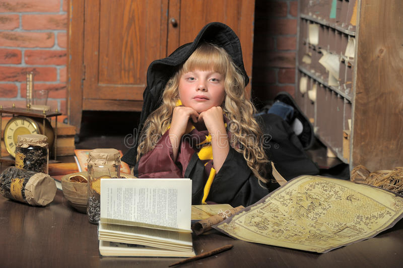 Witch little girl with stack book. . stock photos