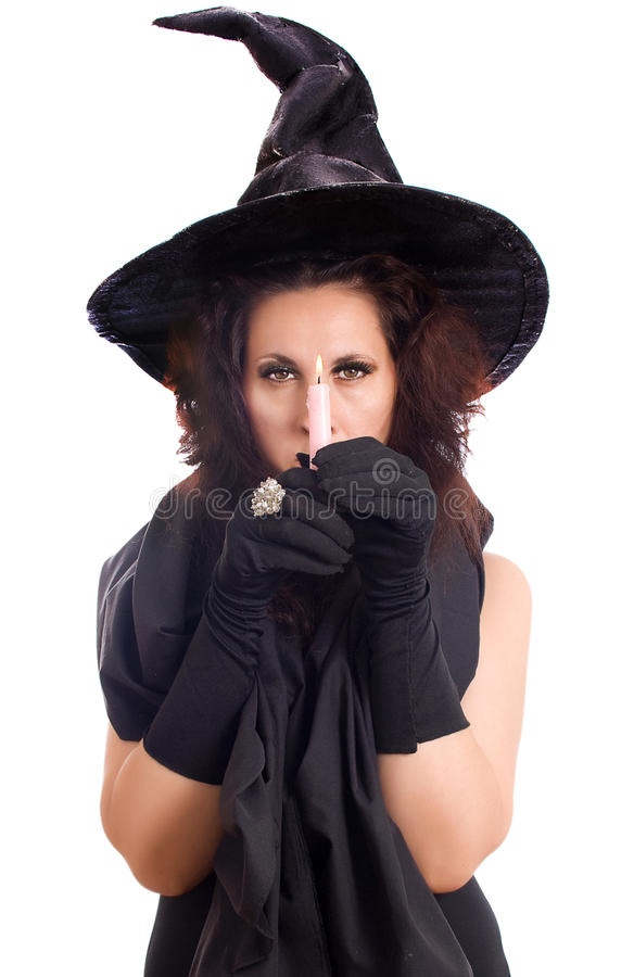 Witch looking through the candle flame royalty free stock image