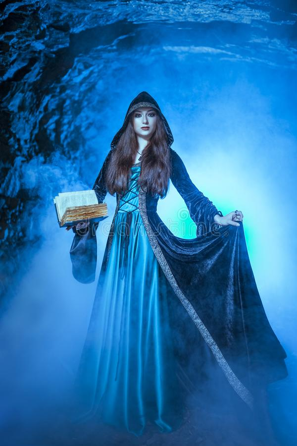 The witch with magic ball in her hands causes a spirits. In cave royalty free stock images