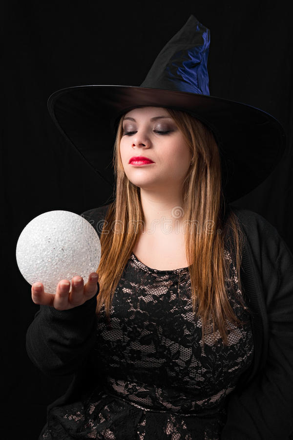 Witch with magic ball. Sensual witch with magic ball royalty free stock photos