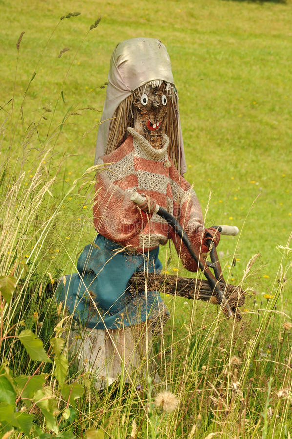 Witch. On meadow, wooden figurine stock photos