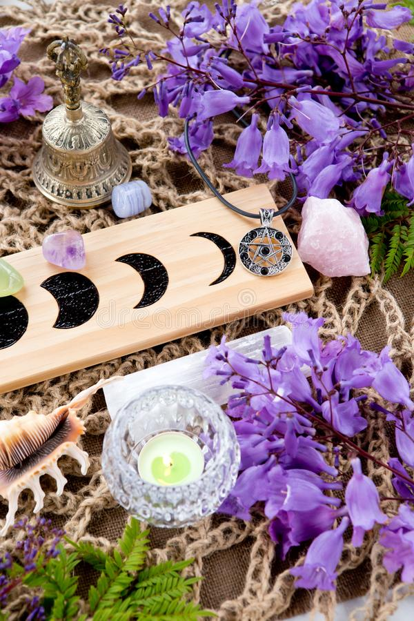 Free Witch Pagan Altar Decorations With Moon Phases, Crystals, Flower Stock Photography - 131278072