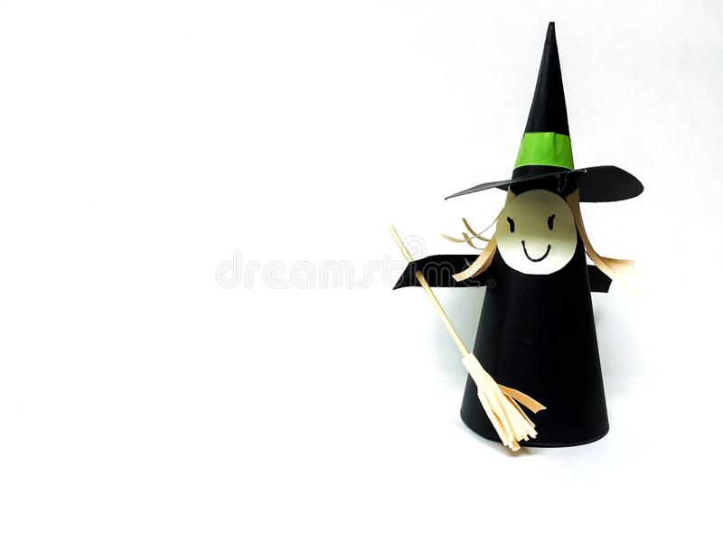 A witch paper craft on white background for Halloween. royalty free stock photo