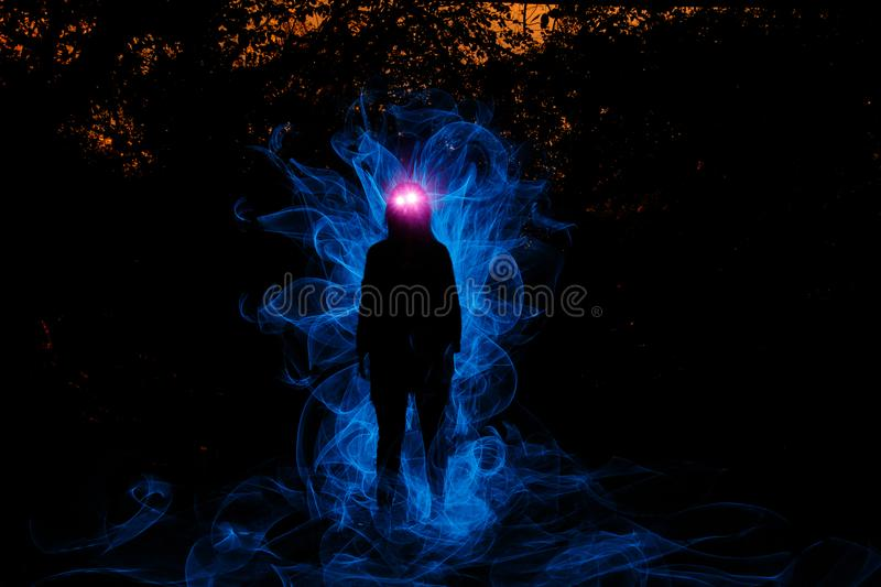 Witch playing with lights stock photography
