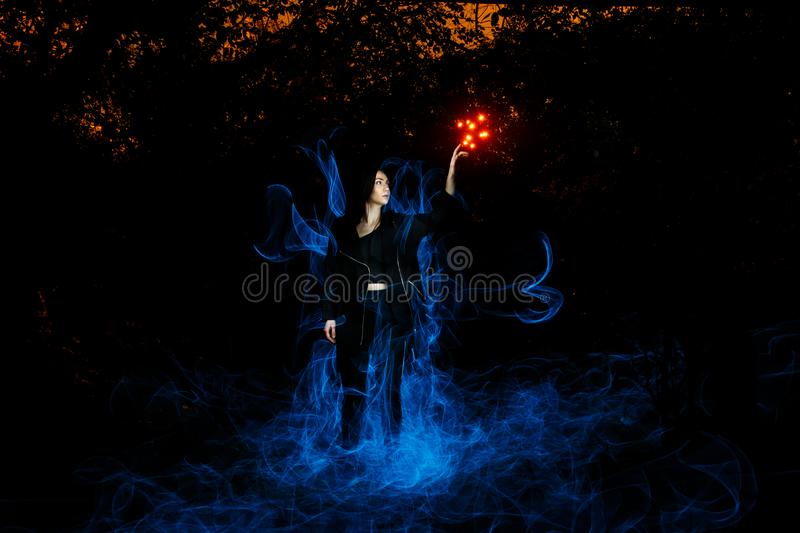 Witch playing with lights royalty free stock photos