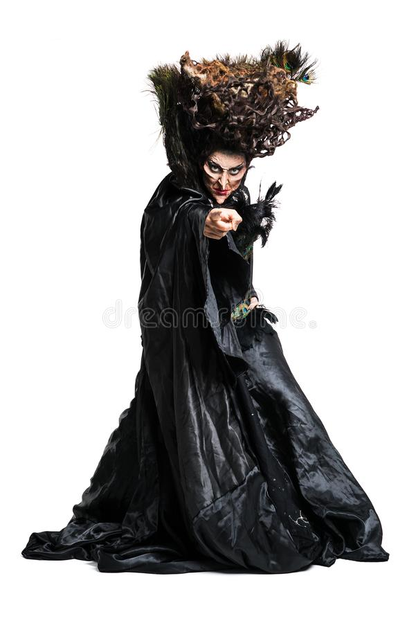 Witch pointing with her finger towards the camera stock photos