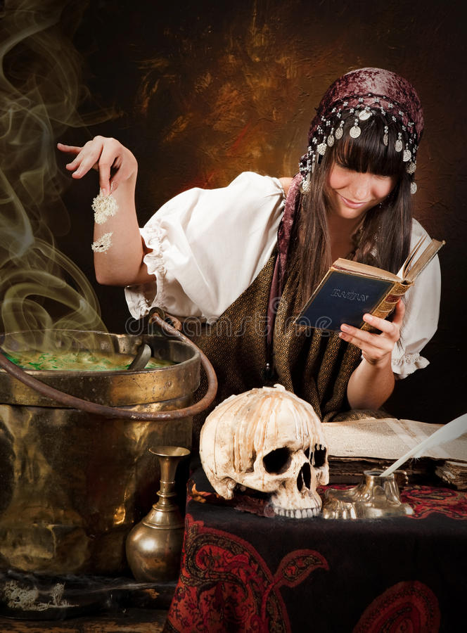 Witch and poison soup royalty free stock images