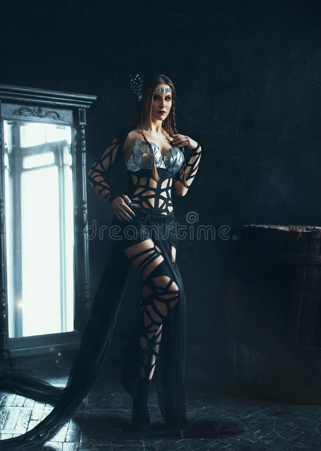 Witch posing near a mirror royalty free stock photos