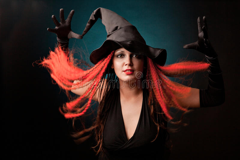 Download Witch Practises Witchcraft On Black Background. Stock Images - Image: 27324564