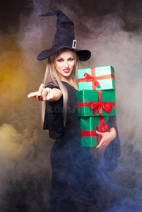 Witch with presents royalty free stock images