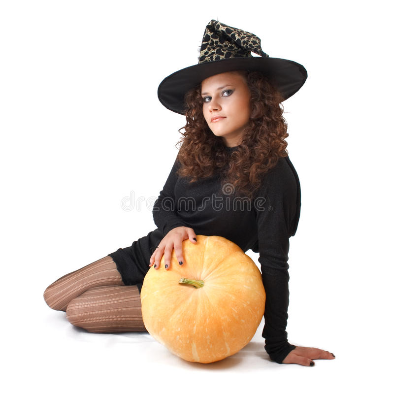 Witch and a pumpkin. royalty free stock photography