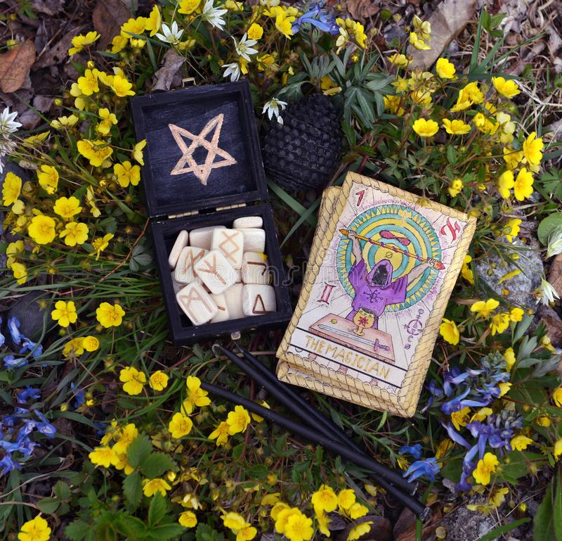 Witch runes, black candles and tarot cards. Wicca, esoteric, divination and occult concept with magic objects for mystic rituals, Halloween, Beltane background royalty free stock images