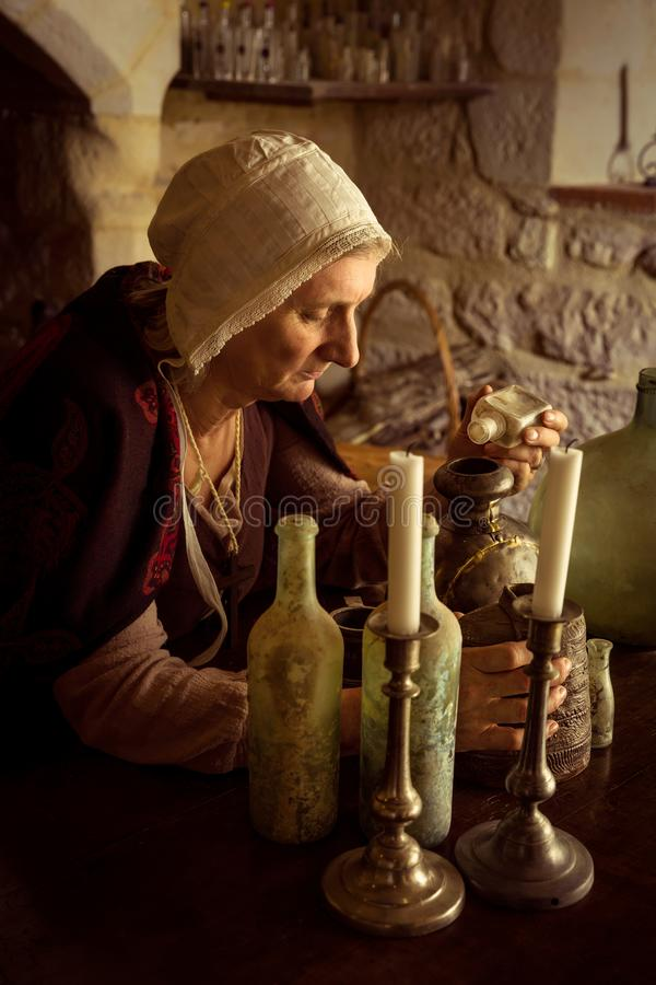 Witch`s alcove with candles and bottles royalty free stock photos