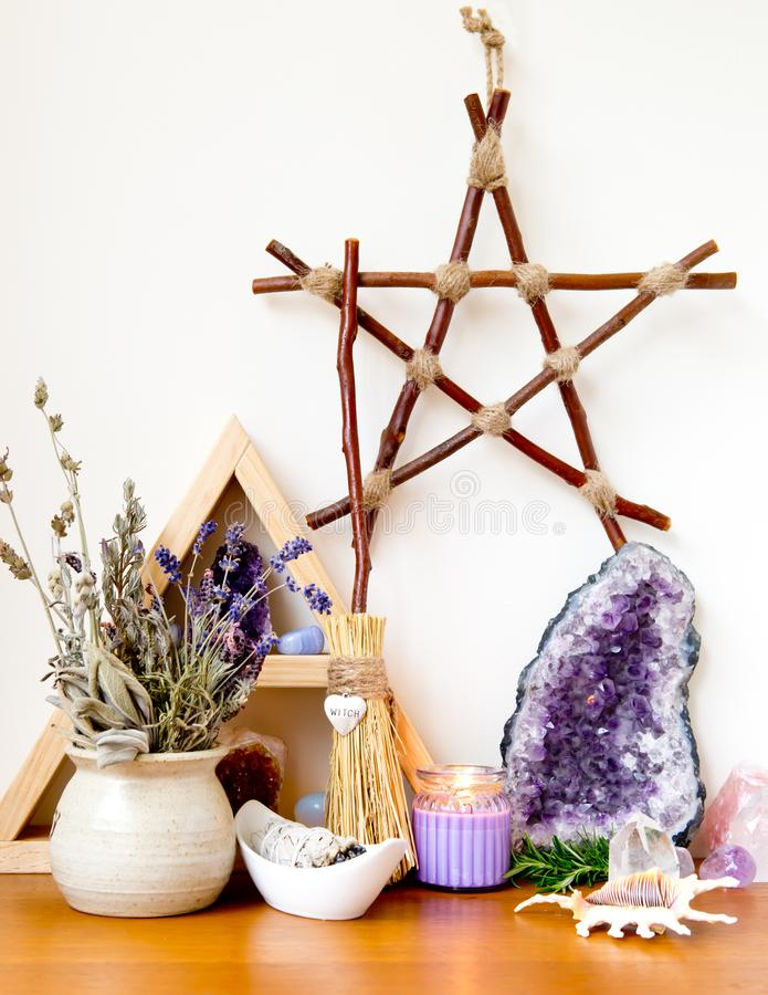 Witch`s Altar with crystals, sage smudge stick, branch pentagram. Witch`s Altar with crystals, sage smudge stick, mini broom with word `witch` in silver heart royalty free stock photo