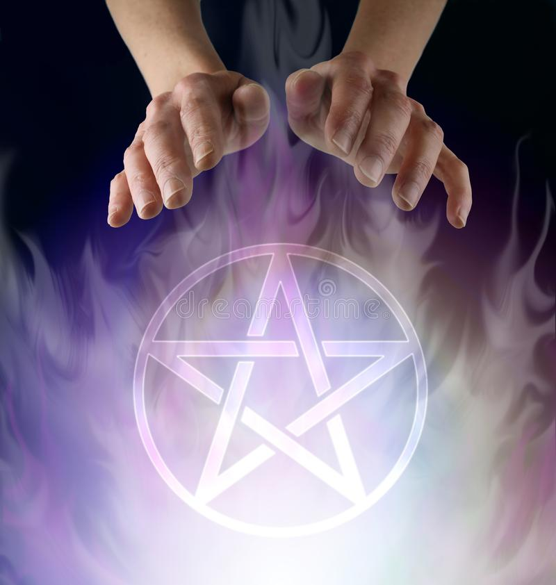 Wiccan Pentacle Ceremony. Witch`s hands hovering above a transparent Pentacle symbol floating in smokey ethereal atmosphere  against a black background with copy stock photo