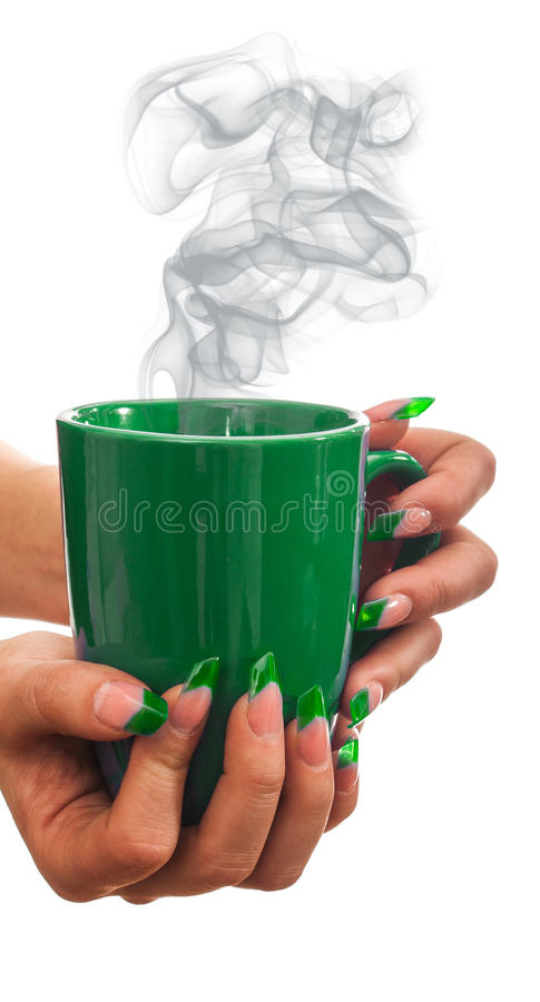 Witch's potion in the hands of sorceress. Witch's potion in a green cup in the hands of the sorceress royalty free stock image