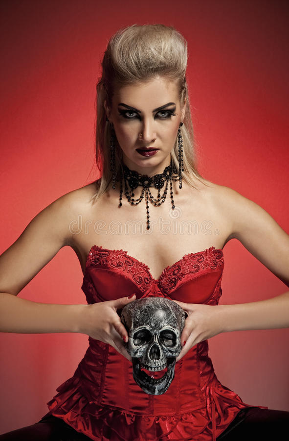 Download Witch with a scull stock photo. Image of hair, attractive - 10891416