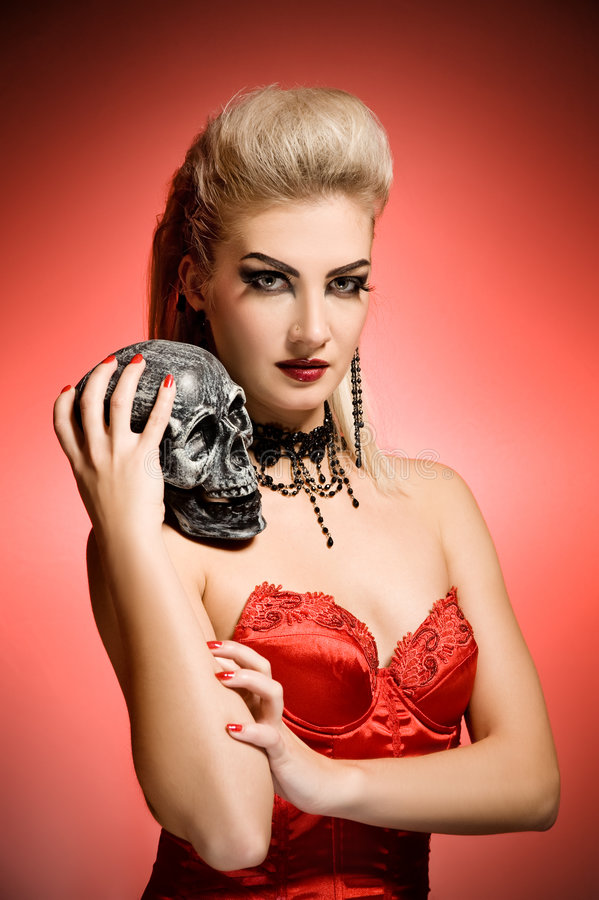 Download Witch with a scull stock image. Image of model, halloween - 6745431