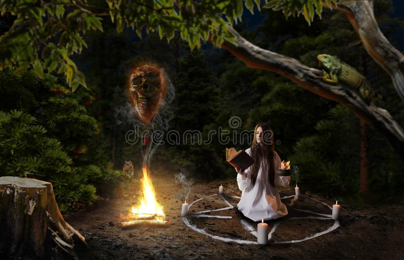 Witch in shirt calling spirits of dead people. Witch in white shirt calling spirits of dead people, pentagram circle with candles, dark magic ritual in the royalty free stock photo