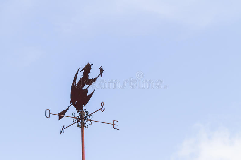 Witch weather Vane. On blue sky background stock image