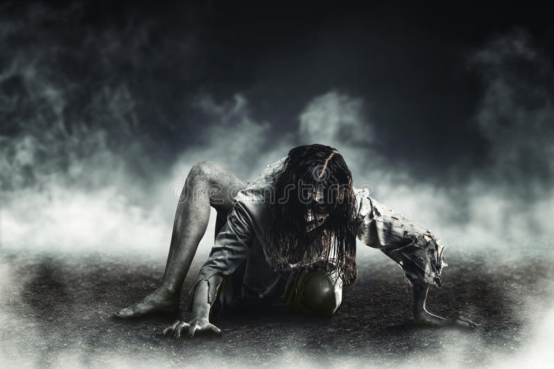 Witch zombie. Horror witch zombie against the background of the soaring earth. Halloween