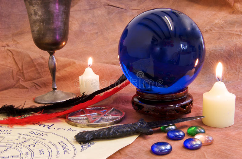 Witchcraft Objects 1. Witchcraft and Wicca objects on a rustic brown background royalty free stock photo