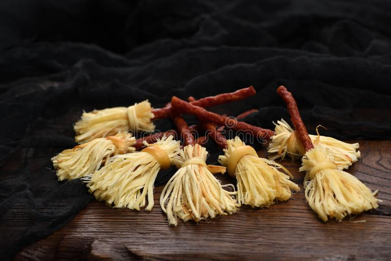 Witches Broom of smoked cheese suluguni and salami stock photos