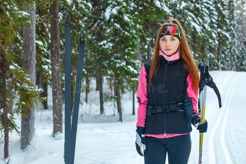 Wite skin woman with a thoughtful cross-country skiing royalty free stock photography