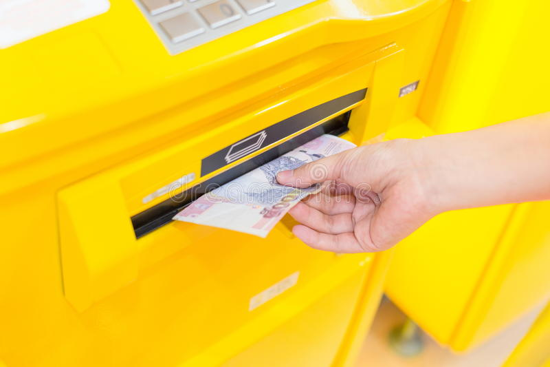 Withdrawing money. From an atm royalty free stock photography