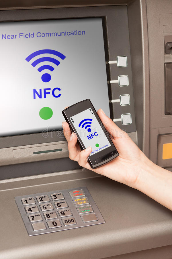 Free Withdrawing Money Atm With Mobile Phone A NFC Terminal Stock Photos - 31368633