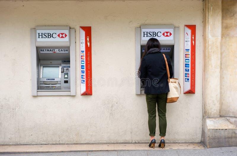 Withdrawing money stock photos