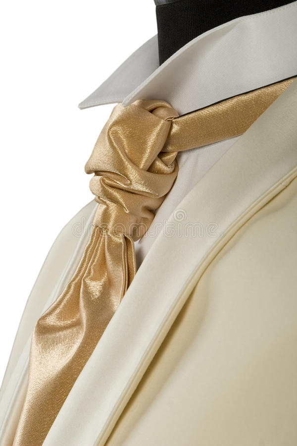 Withe suit and gold tie. Close-up of withe suit and gold tie for ceremony royalty free stock images
