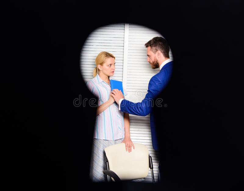 Witness of office crime. Woman suffer violence in office. Dirty secret and blackmail. Discrimination and violence. Occupational violence. View through keyhole stock photos