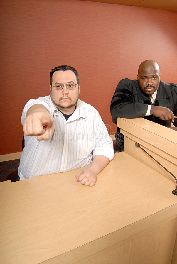 Witness pointing at the accused. Man serving as a witness as trial pointing at the viewer stock photo