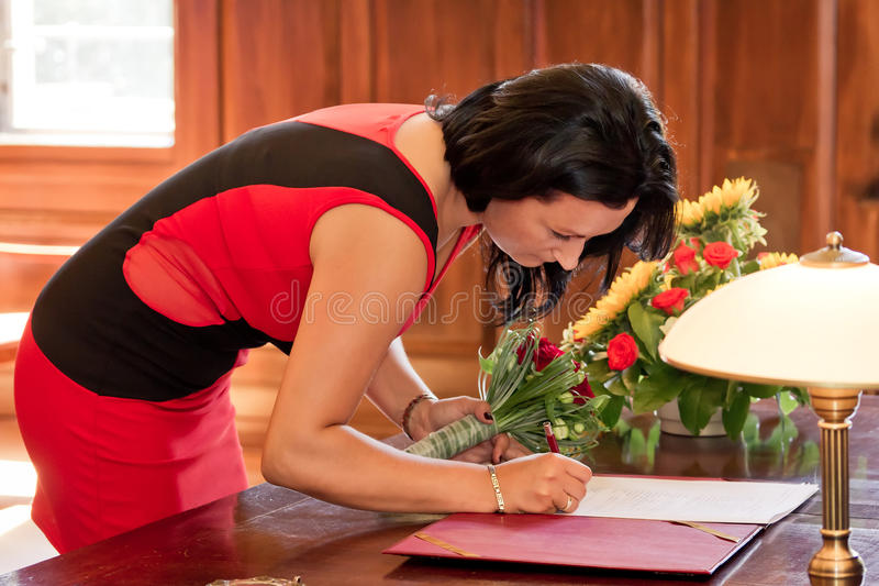 Witness signing marriage form. In the office royalty free stock images