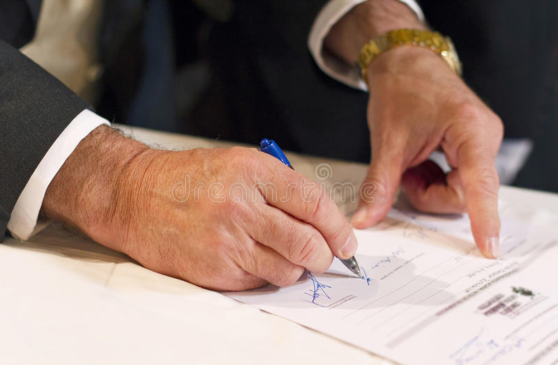 Witness. A witness signing in a wedding royalty free stock images