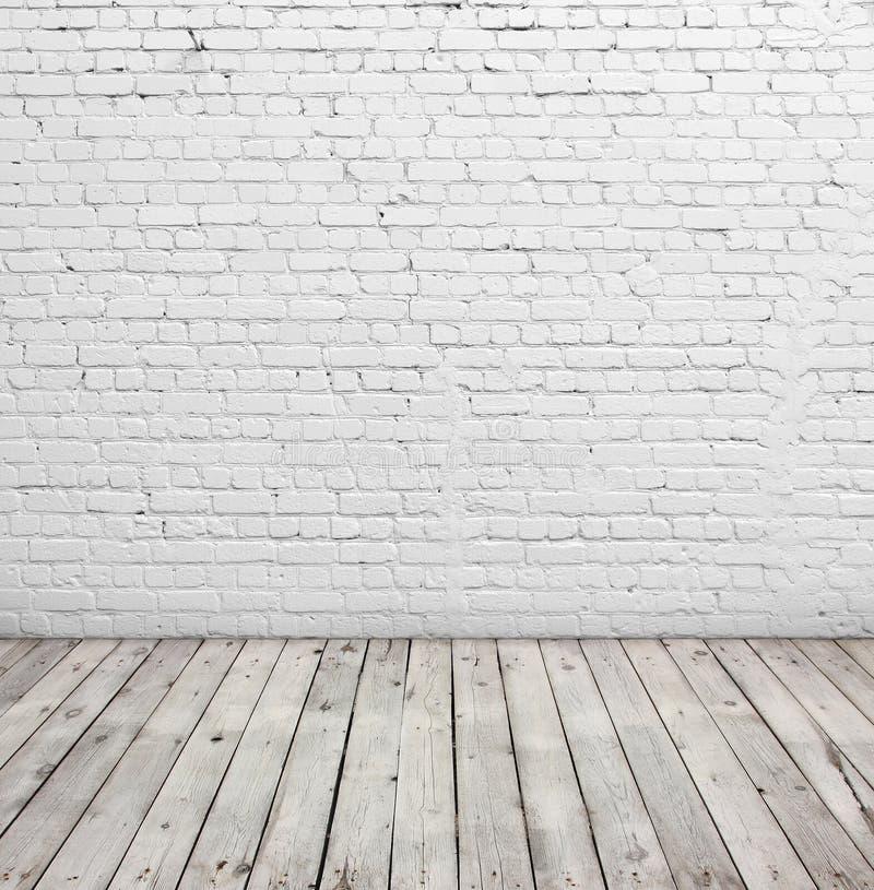 Witte bakstenen muur en houten vloer royalty-vrije stock fotografie