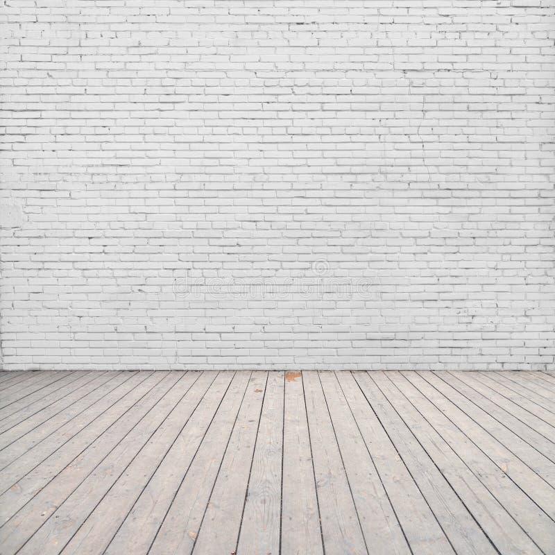 Witte bakstenen muur en houten vloer royalty-vrije stock foto